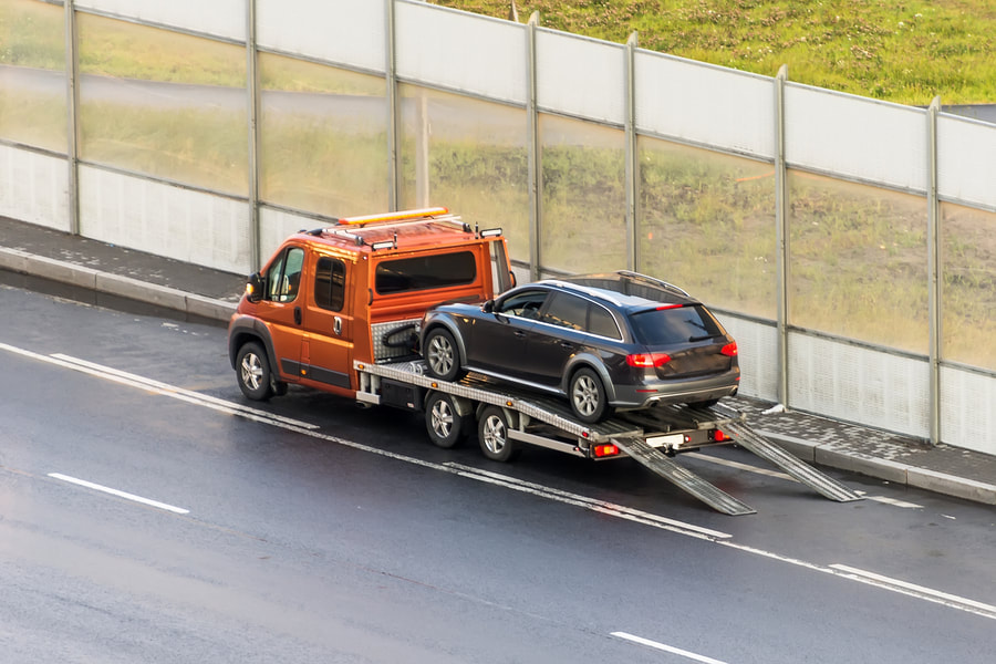 towing truck with a black car